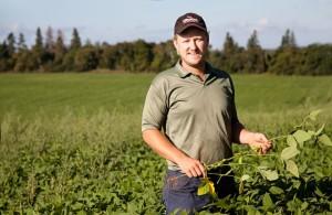 Drew Jeffrey in his field of organic soybeans